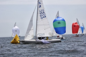 Some separation in the fleet by the leeward mark. Photo Credit Stu Johnstone.